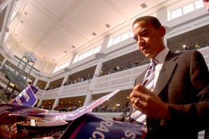 Barack Obama signs flyers in the Johnson Center in 2007.