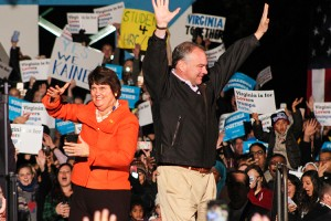 VP nominee Tim Kaine and wife Anne Holton wave to supporters at Monday night's rally.
