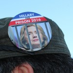 A Trump supporter's button suggests Hillary Clinton should be imprisoned.
